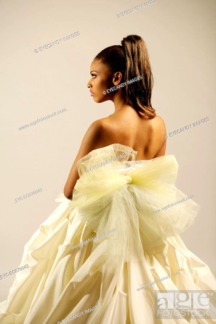 Stock Photo: Young African American woman in elegant gown, studio shot.