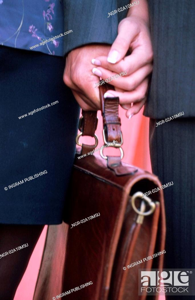 Stock Photo: Briefcase in the hand of a Man and Woman.