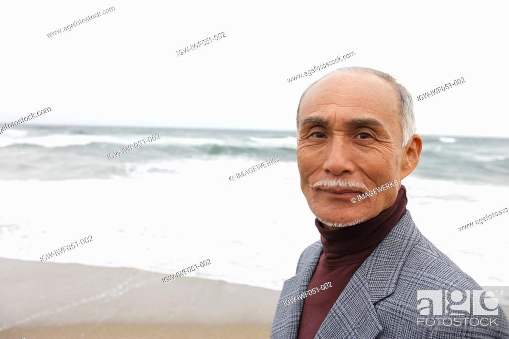 Stock Photo: Senior man smiling, portrait.