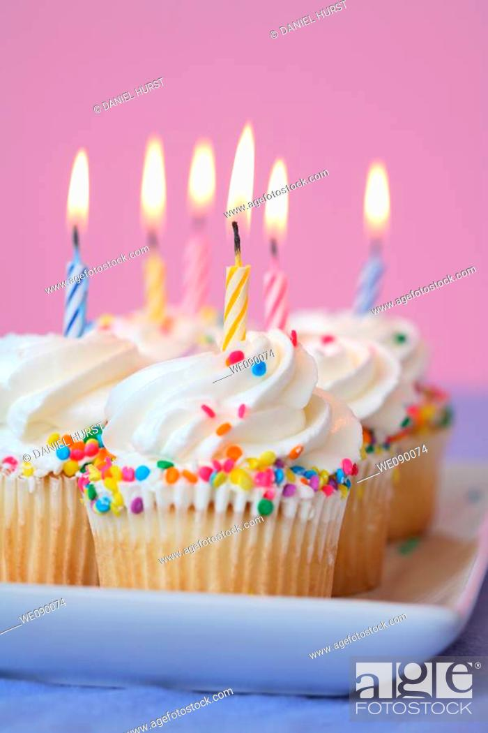 Stock Photo: Birthday cupcakes.