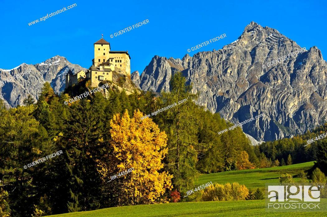 Stock Photo: Autumn landscape with Tarasp Castle, Tarasp, Scuol, Lower Engadine, Grisons, Switzerland.