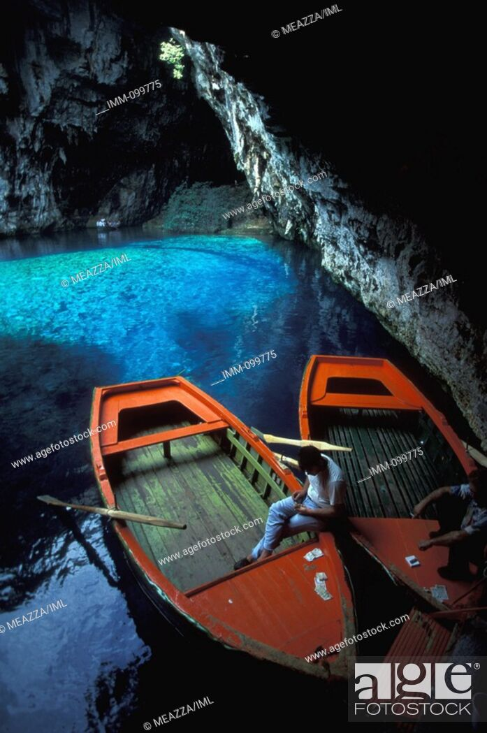 Stock Photo: Eptanese, Kefallonia Melissani Cave: outside cave, Man in boat, money.