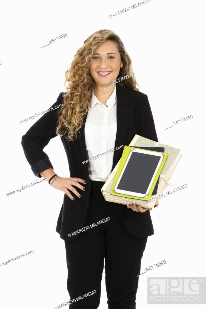 Stock Photo: Businesswoman standing in the studio with tablet and documents in her arms, she is wearing a black suit and a white shirt.