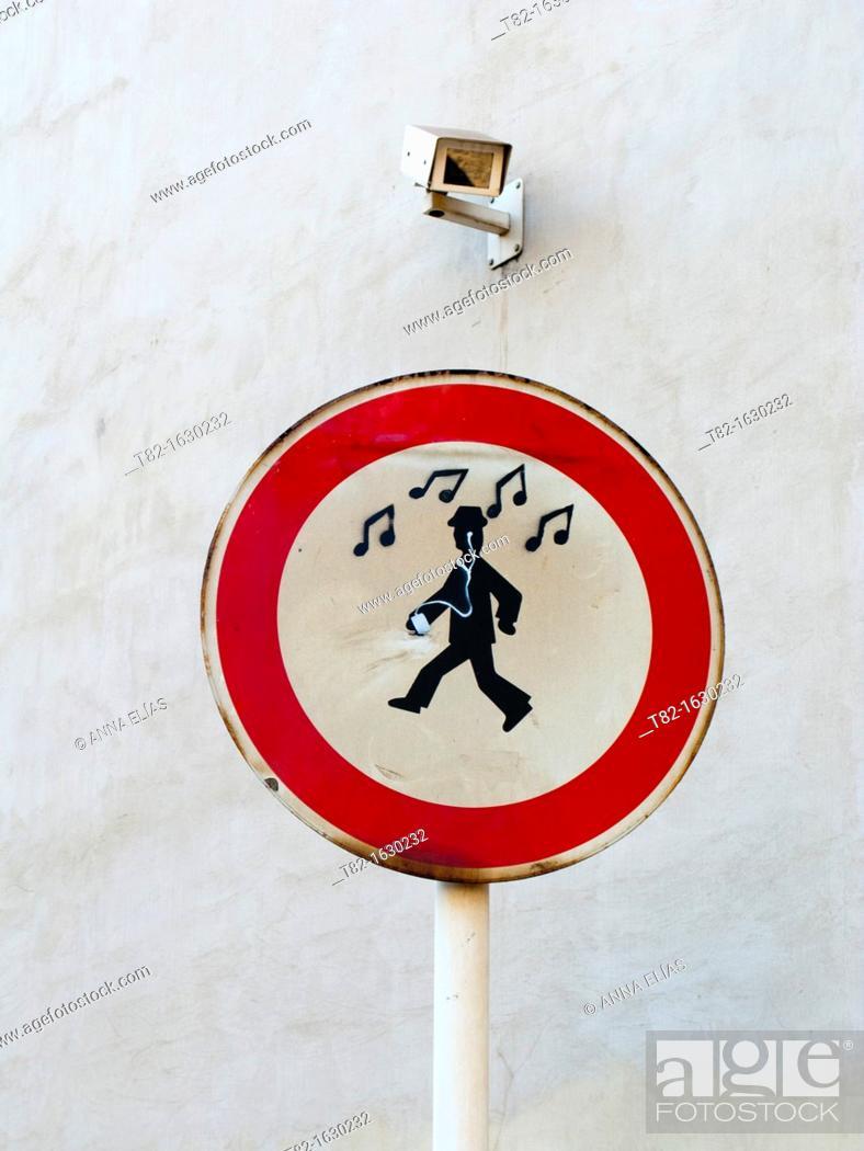 Stock Photo: prohibition signal drawn graffiti of man listening to music.
