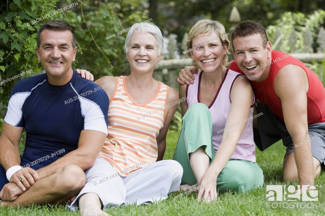 Stock Photo: Portrait of two mature couples smiling in a park.