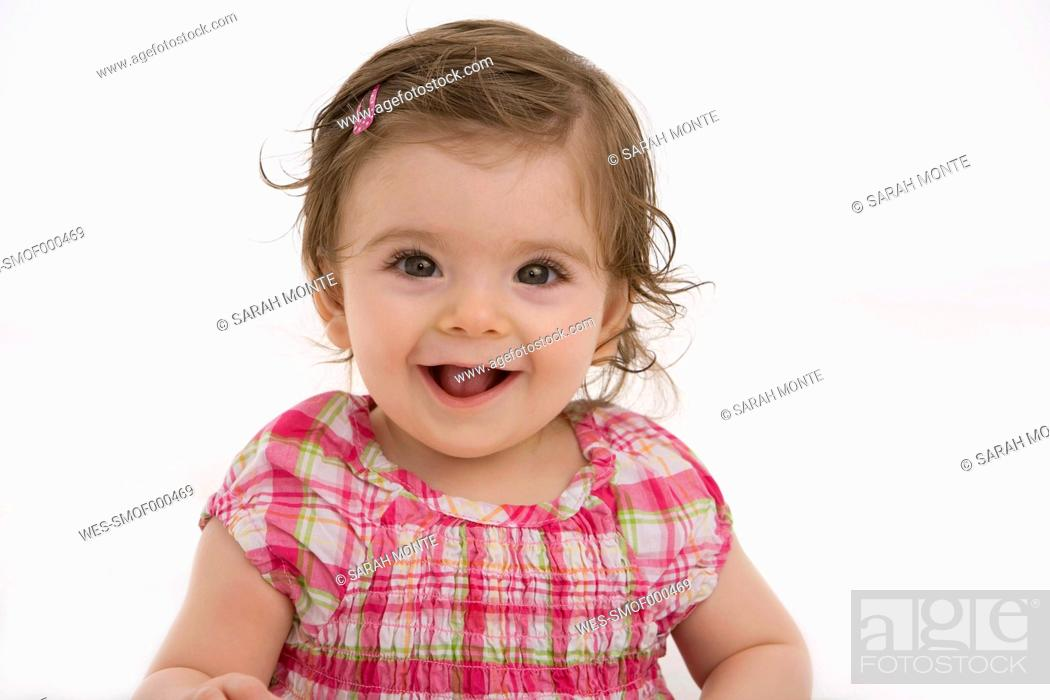 Stock Photo: Close up of baby girl, smiling.