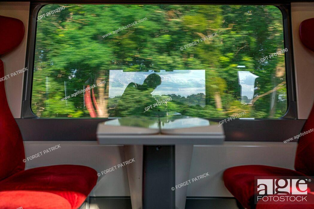 Stock Photo: TRAIN TRIP ON THE SNCF RAILWAY LINE PARIS-GRANVILLE.