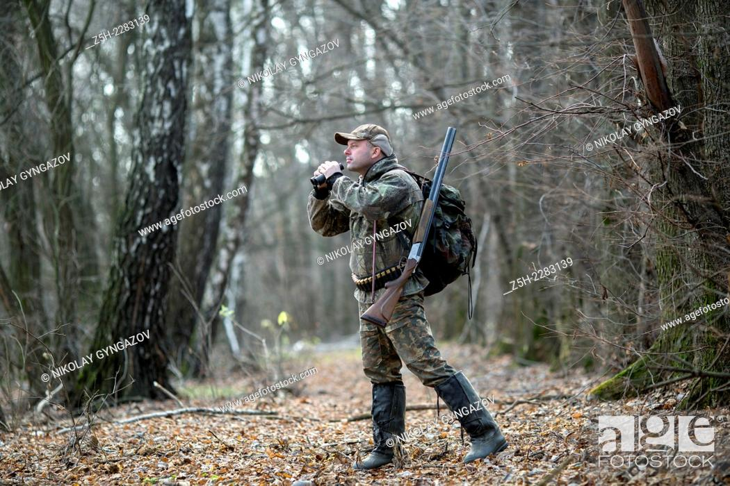 Stock Photo: Man in camouflage on autumn hunting.