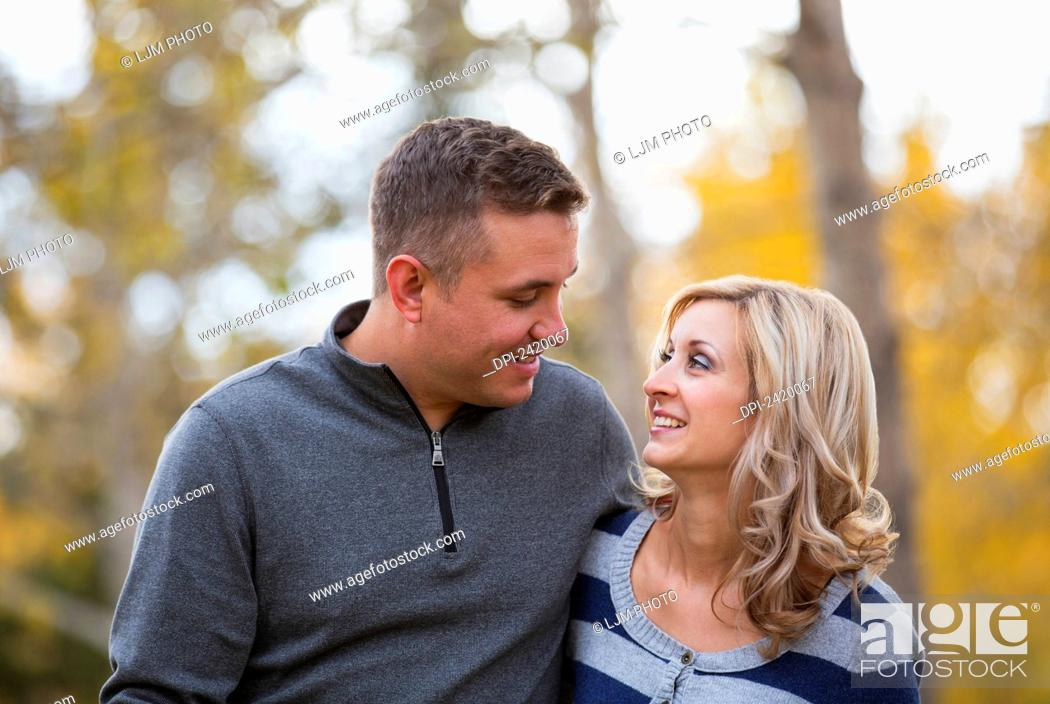 Stock Photo: Married couple spending quality time together in a park in autumn; Edmonton, Alberta, Canada.