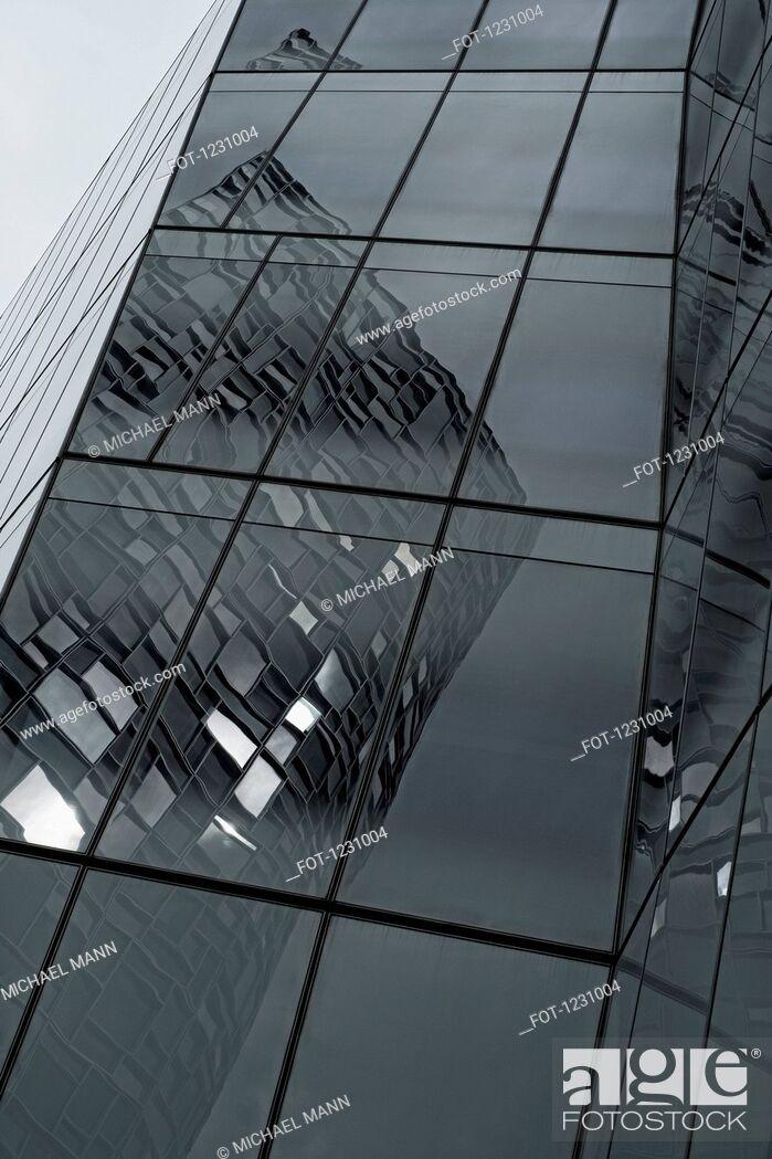 Stock Photo: Skyscraper's bent reflections.