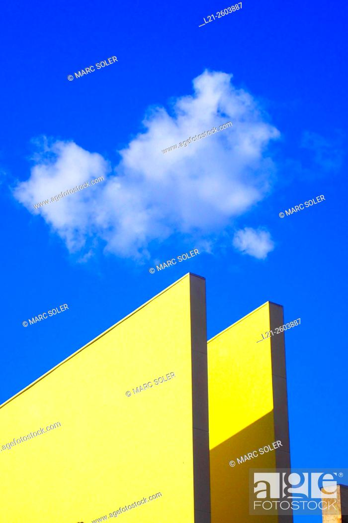 Stock Photo: Architectural detail of triangular shape topped by a cloud on a blue sky. Barcelona, Catalonia, Spain.