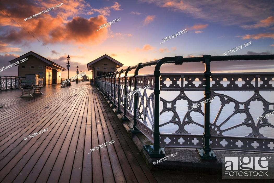 Stock Photo: Sunrise captured from the Victorian Pier at Penarth in South Wales.