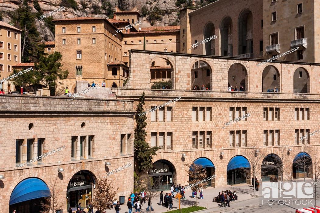 Stock Photo: View of the Sanctuary of Benedictine abbey Santa Maria de Montserrat and the shop and cafeteria at street level on Plaça de a Creu.