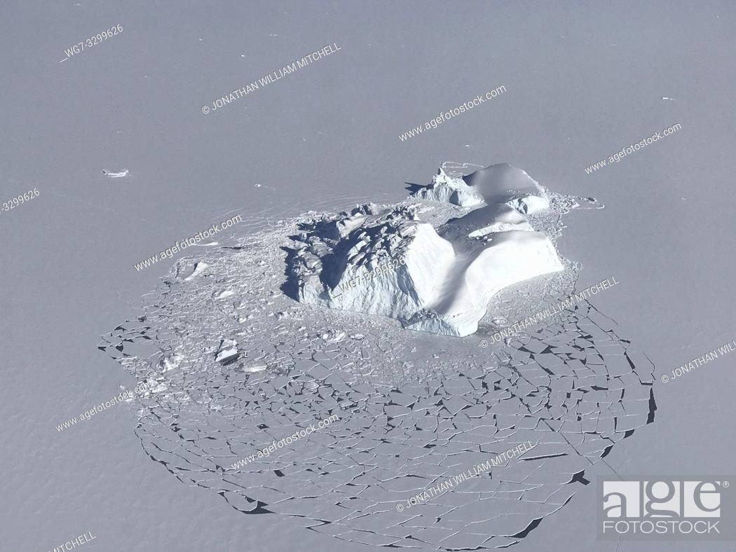 Stock Photo: GREENLAND - April 21, 2018 - Aerial view of an iceberg near Vestfjord Glacier in Scoresby Sund, along the eastern coast of Greenland.