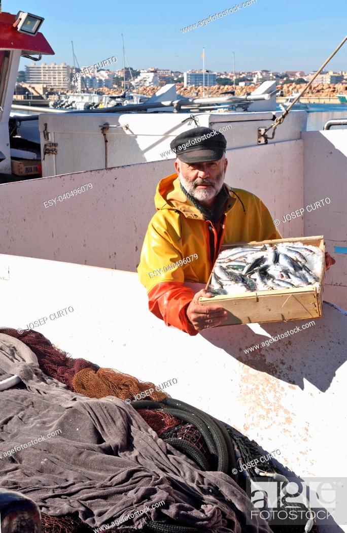 Stock Photo: fisherman in the fishing port of Escala, Costa Brava, Girona province, Spain.
