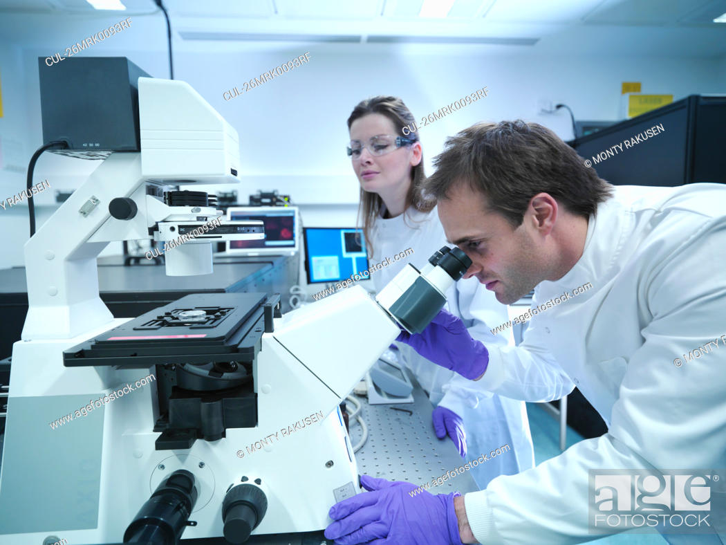Stock Photo: Scientists using laser microscope.