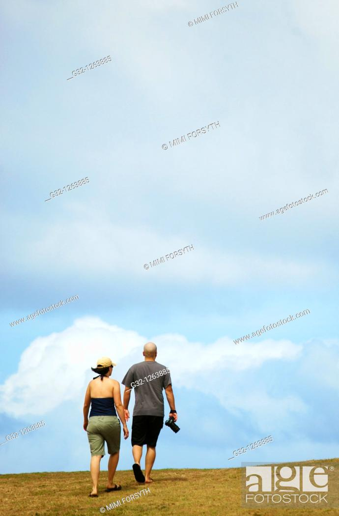 Stock Photo: Couple walking to top of hill.