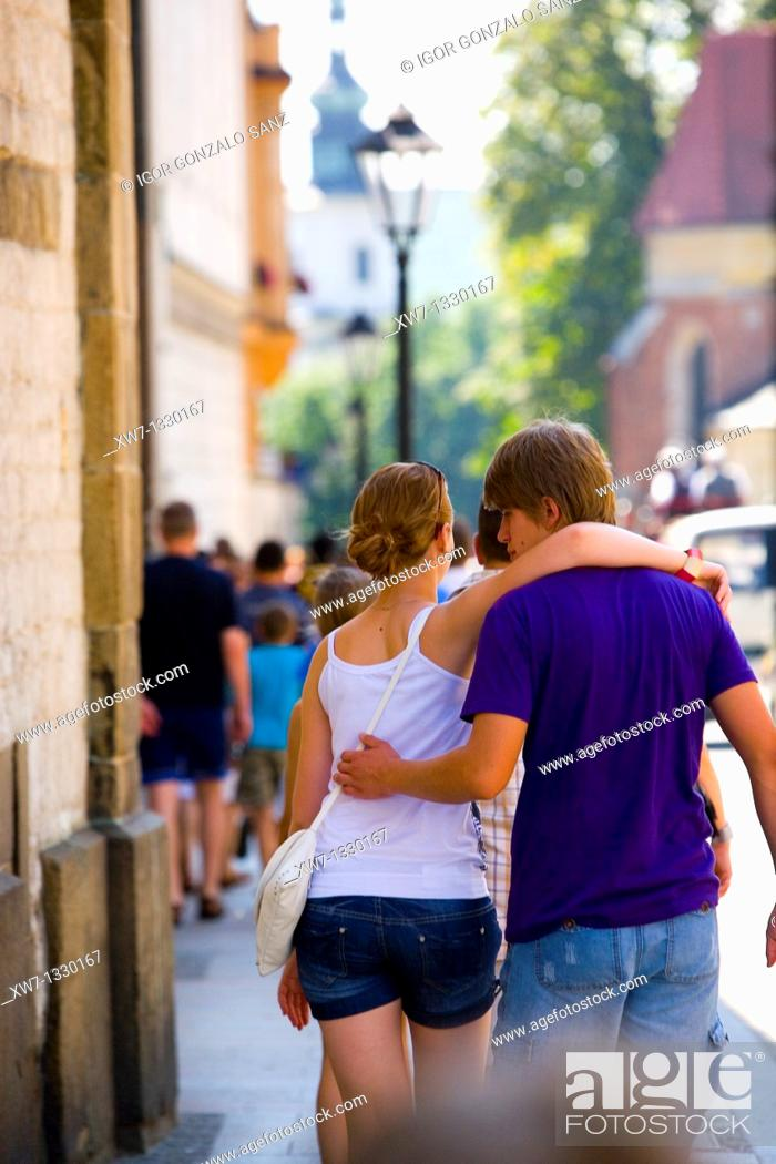 Stock Photo: Couple walking at the city centre of Krakow, Poland.