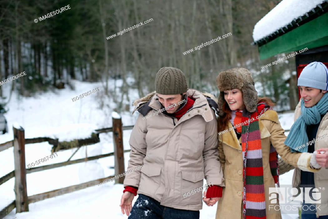 Stock Photo: Friends walking in the snow.
