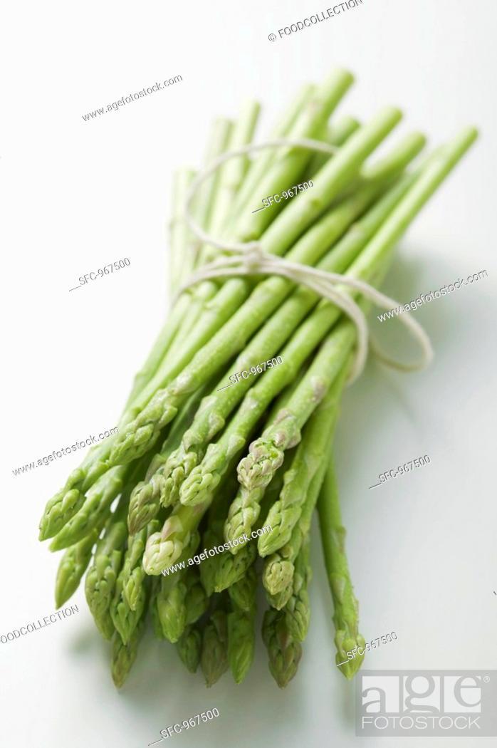 Stock Photo: A bundle of green asparagus.