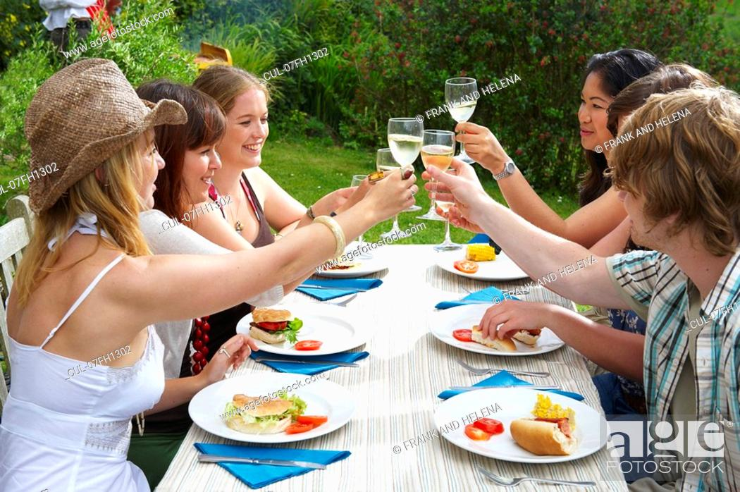 Stock Photo: Young people toasting each other.