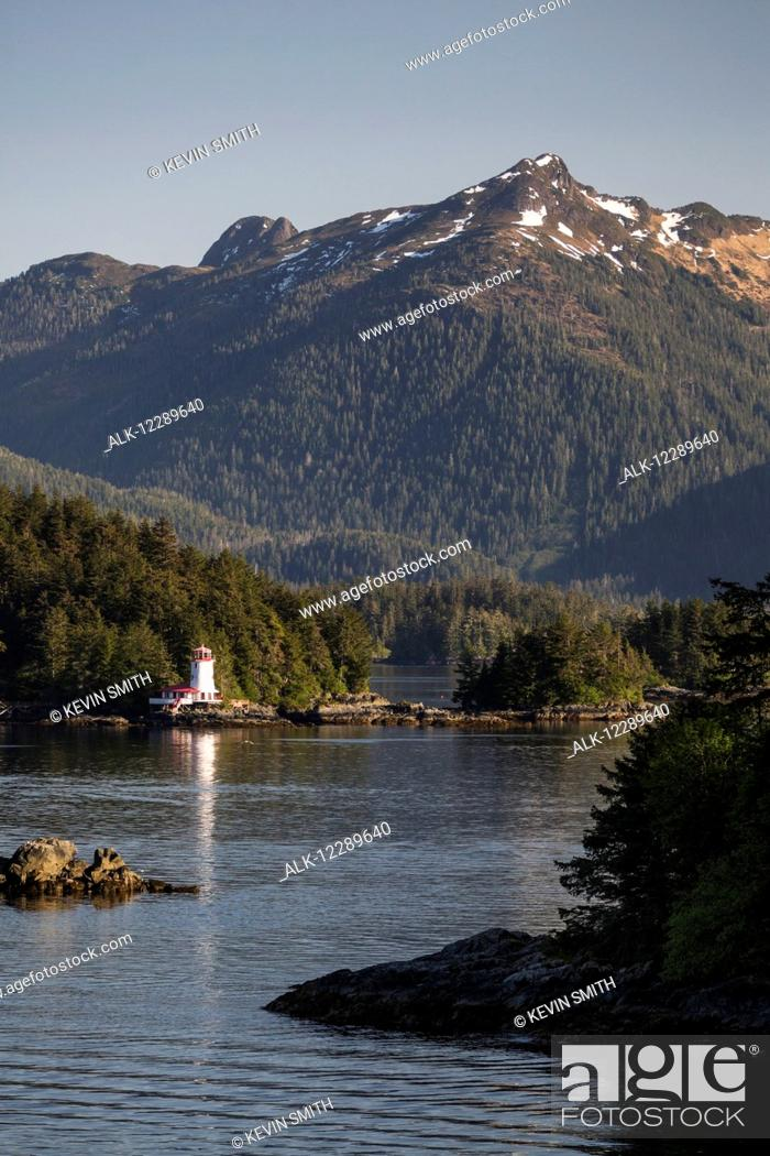 Stock Photo: Small islands populated by Sitka spruce trees, a lighthouse in the background; Sitka, Alaska, United States of America.
