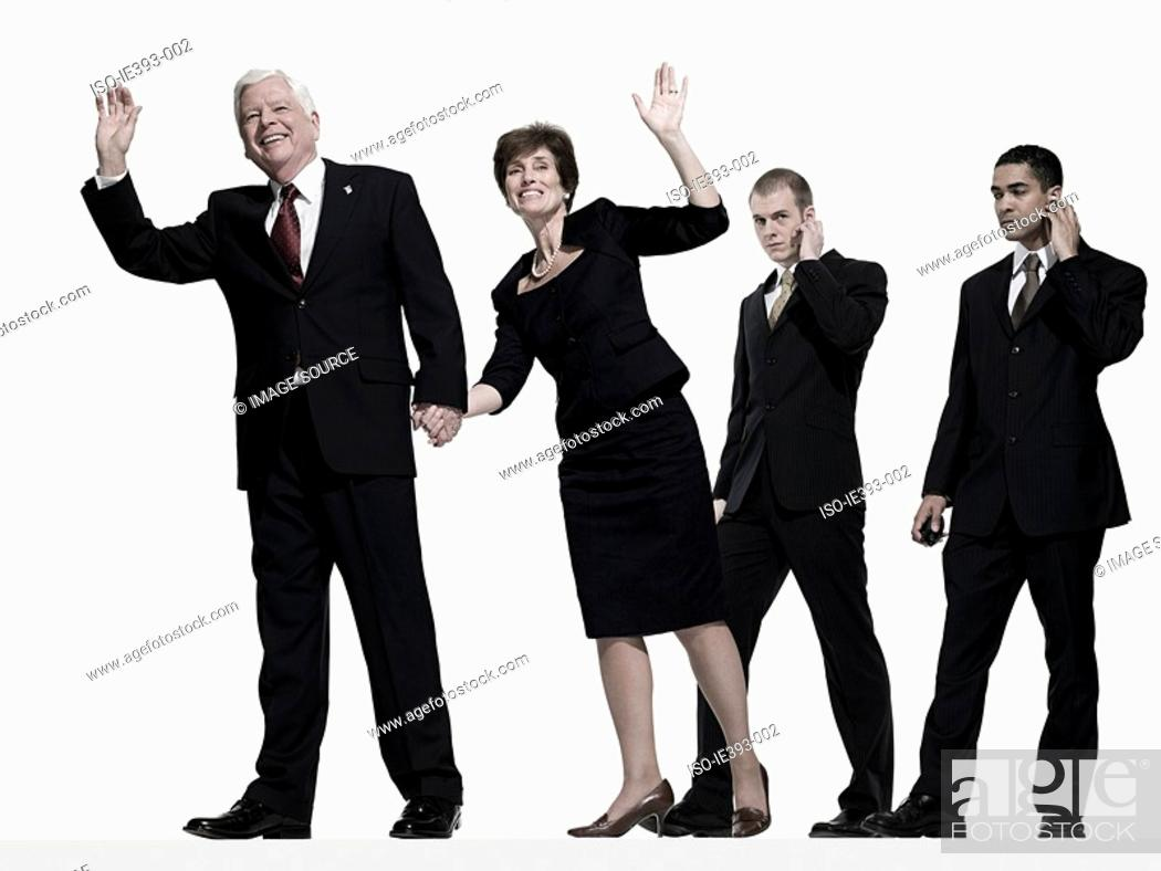 Stock Photo: Politician and wife with bodyguards.