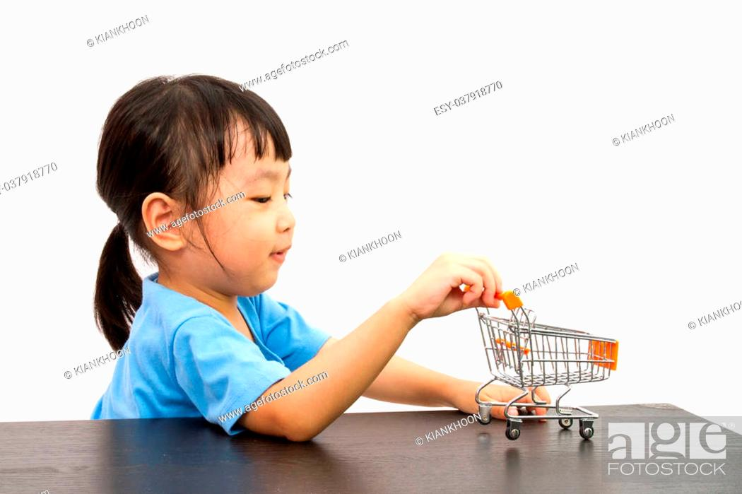 6f23c0d634c1 A girl pushing a toy trolley Stock Photos and Images