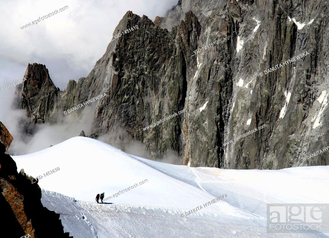 Stock Photo: Two climbers seen from Aiguille du Midi , Mont Blanc mountain range, close to Chamonix , Haute-Savoie , Auvergne-Rhône-Alpes, France , Europe.