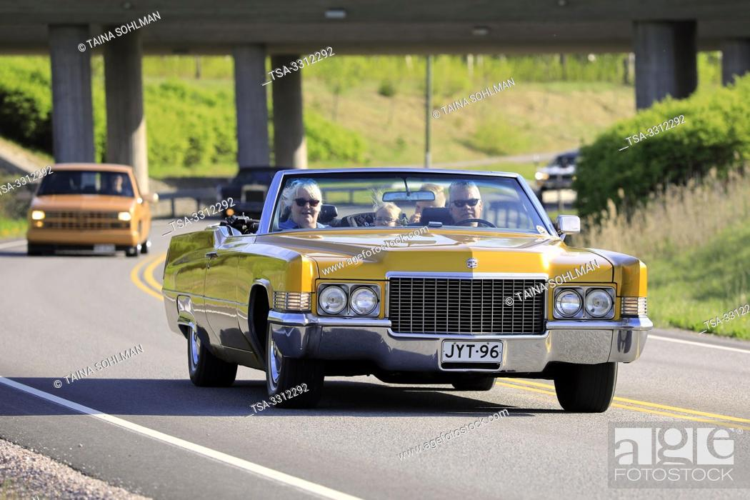Stock Photo: Salo, Finland. May 18, 2019. People cruising on classic yellow 1970s Cadillac convertible along highway on Salon Maisema Cruising 2019.