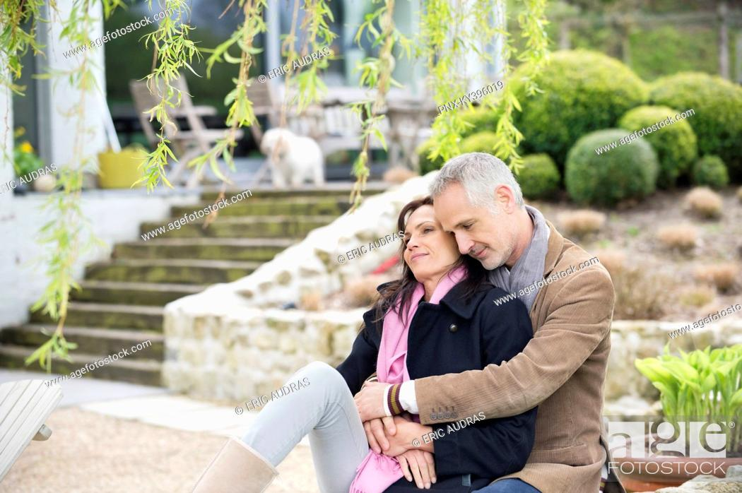 Stock Photo: Romantic couple sitting in a garden.