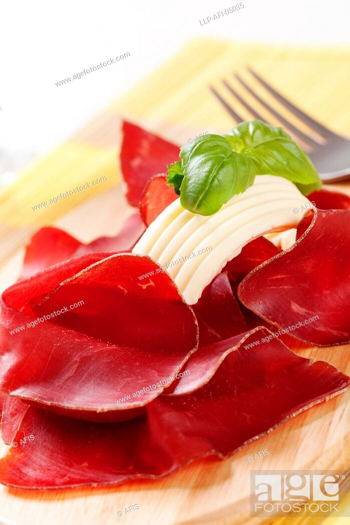 Stock Photo: Thin slices of dry cured ham and butter.
