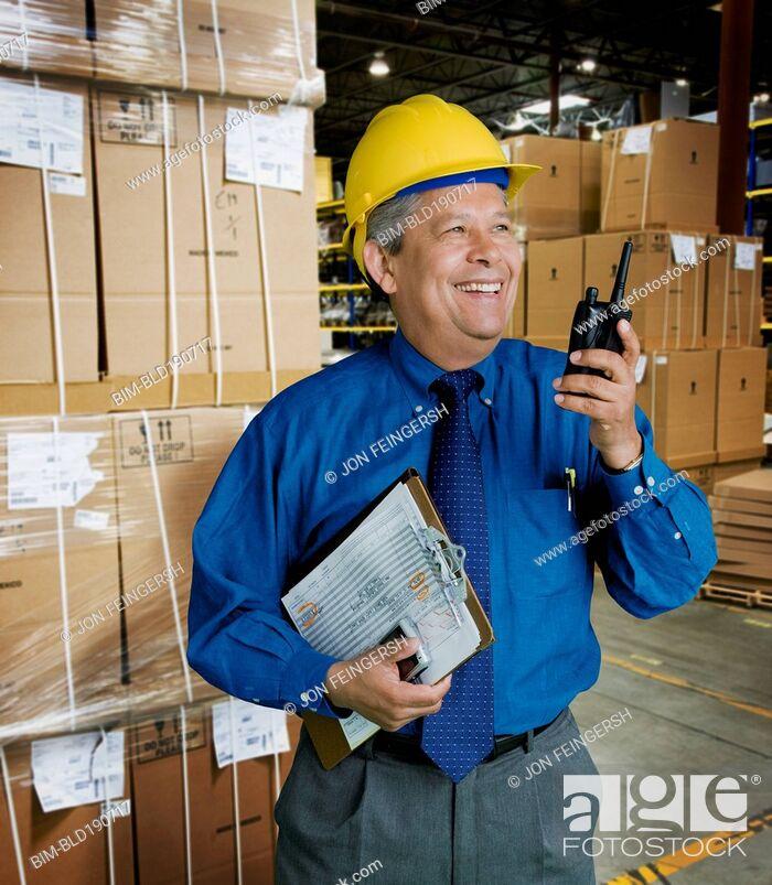 Stock Photo: Hispanic man working in warehouse.