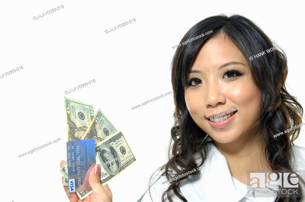 Stock Photo: Woman with dollar bills and a credit card.