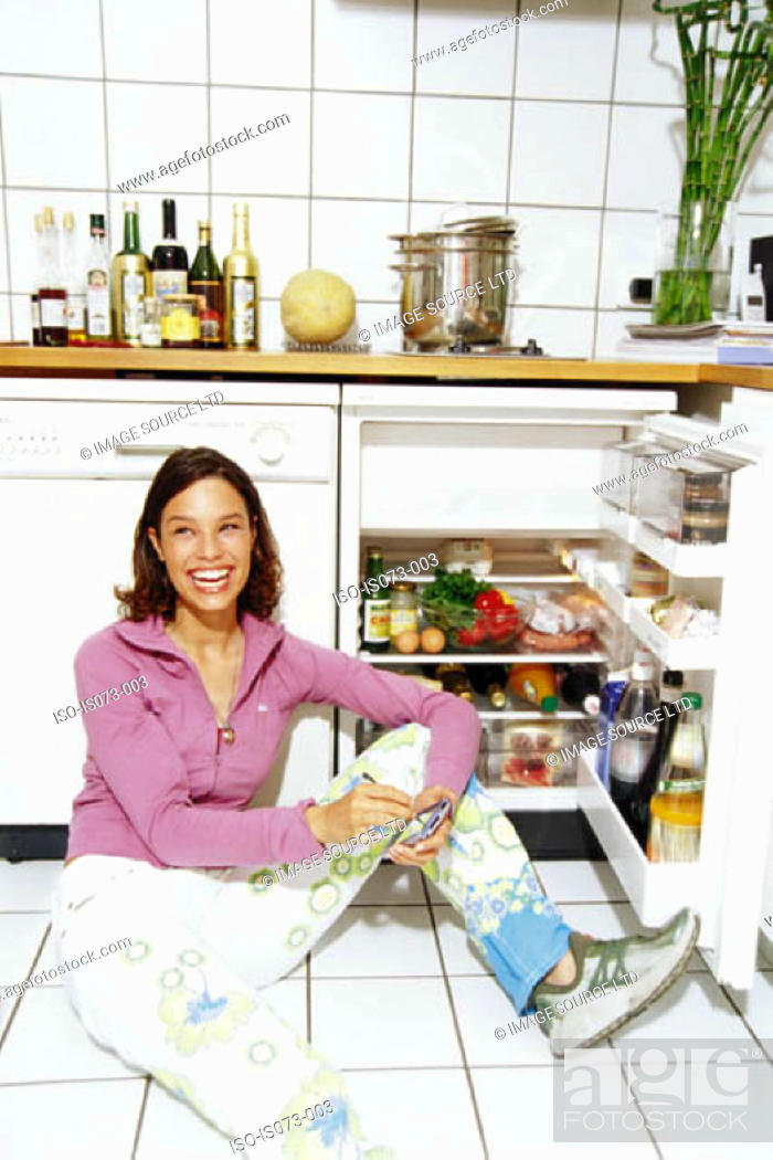 Stock Photo: Girl in kitchen.