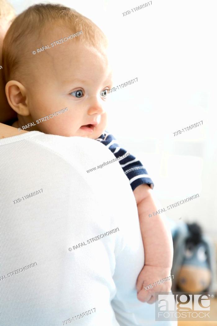 Stock Photo: mum carrying baby.