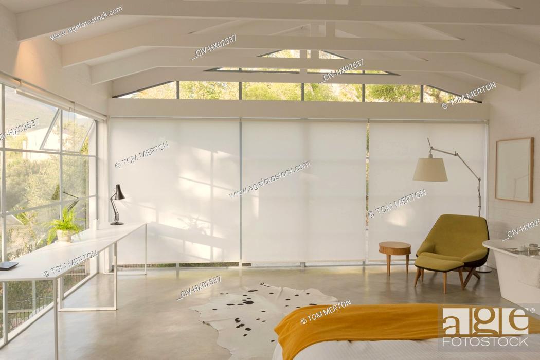 Stock Photo: Modern, minimalist bedroom with vaulted wood beam ceiling.