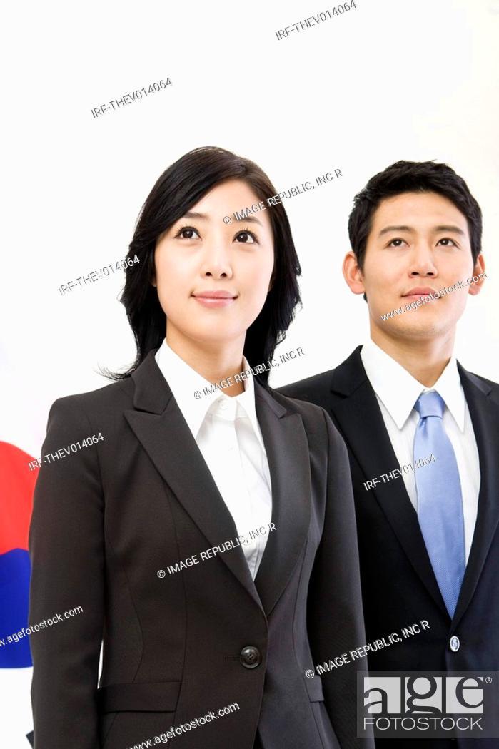 Stock Photo: businessman and businesswoman in front of Korean flag, Taegeukgi.