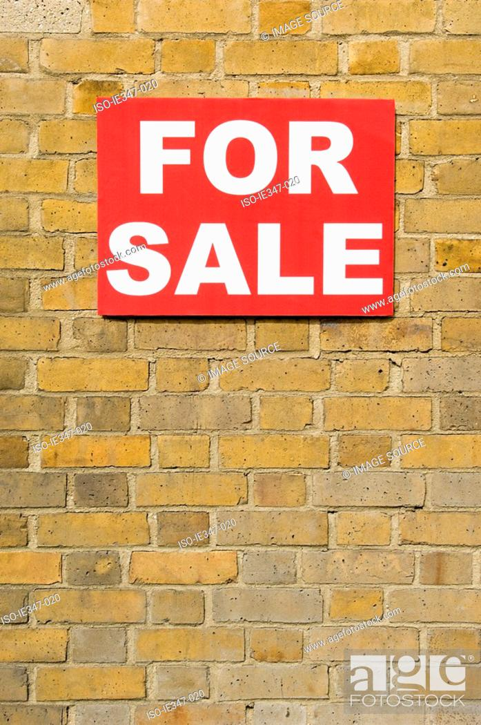 Stock Photo: For sale sign on wall.