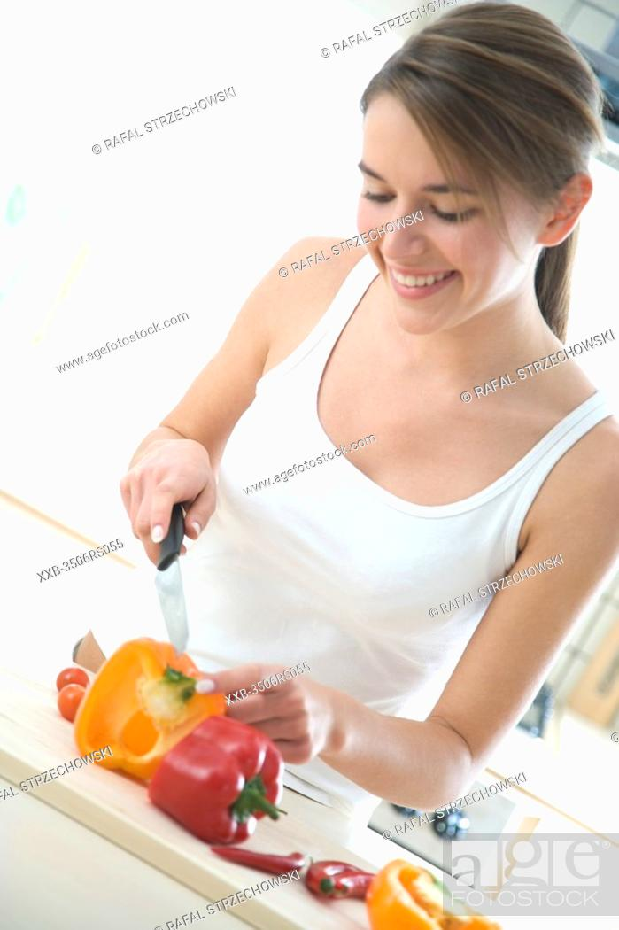 Stock Photo: woman cutting vegetables.