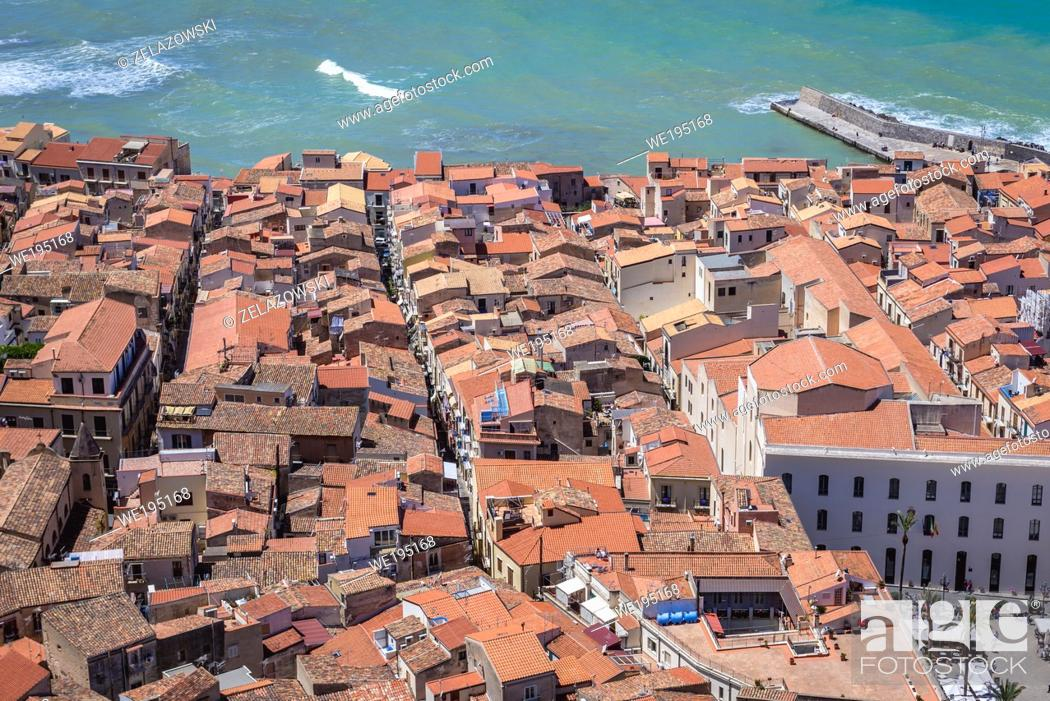 Stock Photo: Old town houses on the Tyrrhenian coast in Cefalu city on Sicily Island, Italy - view from rock massif called Rocca di Cefalu.