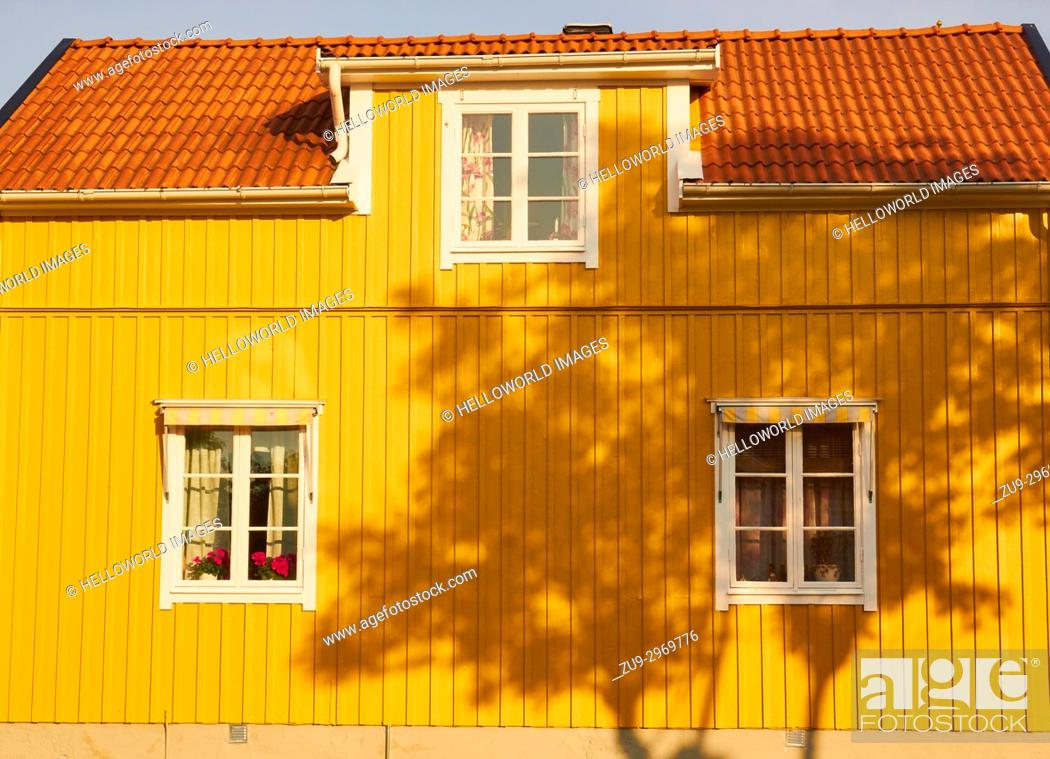 Stock Photo: Shadow of tree on yellow painted timber house, Sweden, Scandinavia.