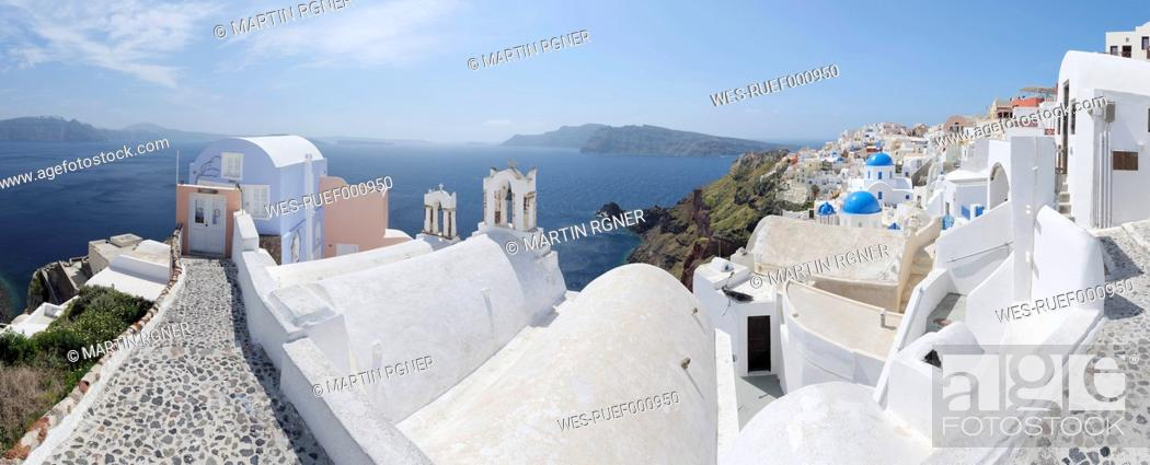Stock Photo: Greece, View of Oia village with cobbled path and bell tower at Santorini.
