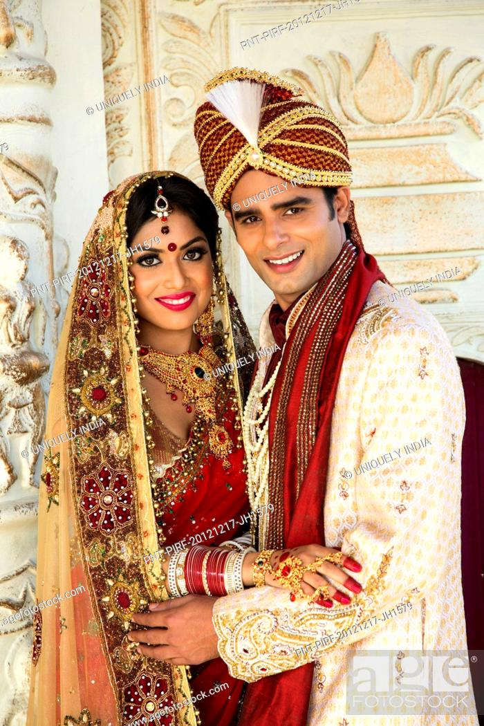 Indian bride and groom in traditional wedding dress, Stock Photo ...