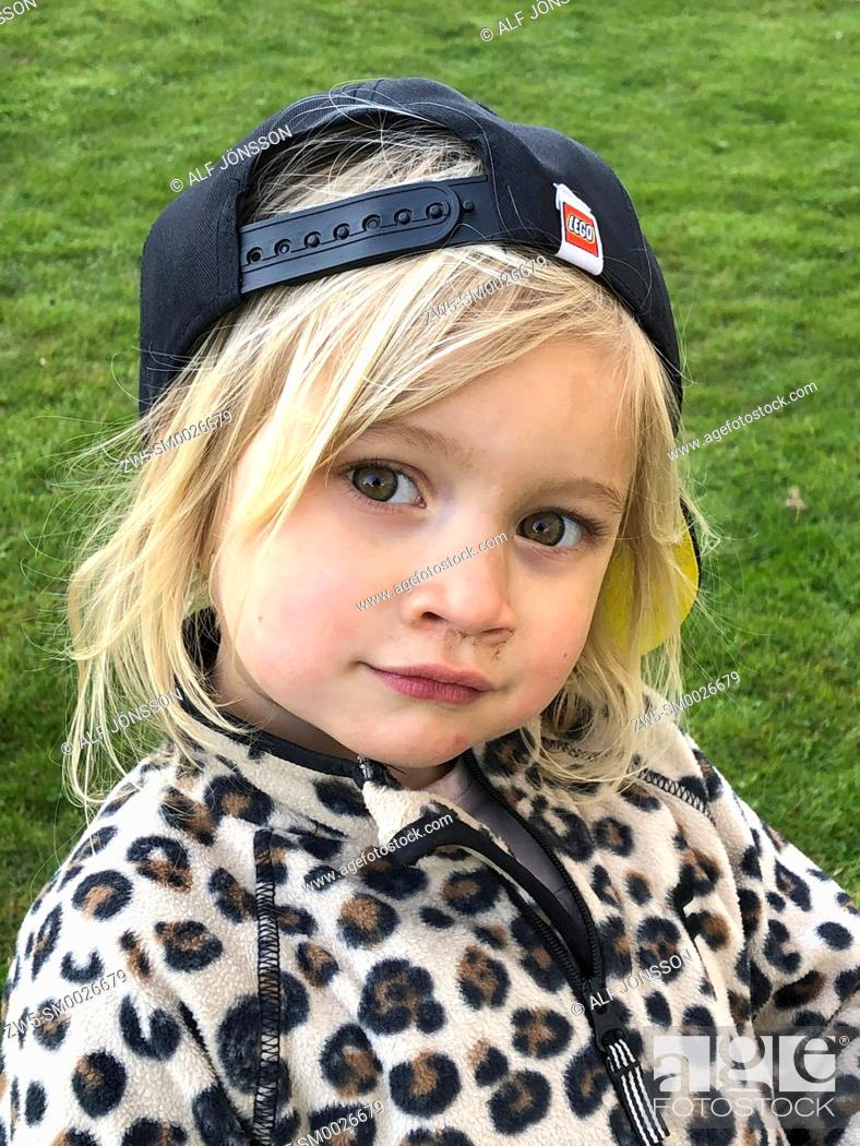 Stock Photo: Portrait on a blond three years old girl.
