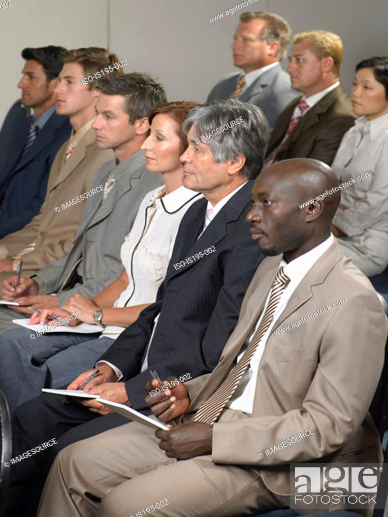 Stock Photo: Office workers listening to a speech.