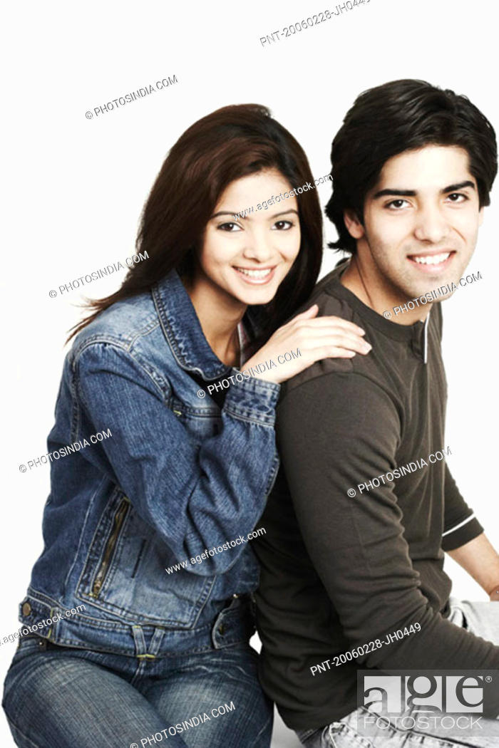 Stock Photo: Portrait of a young couple smiling.