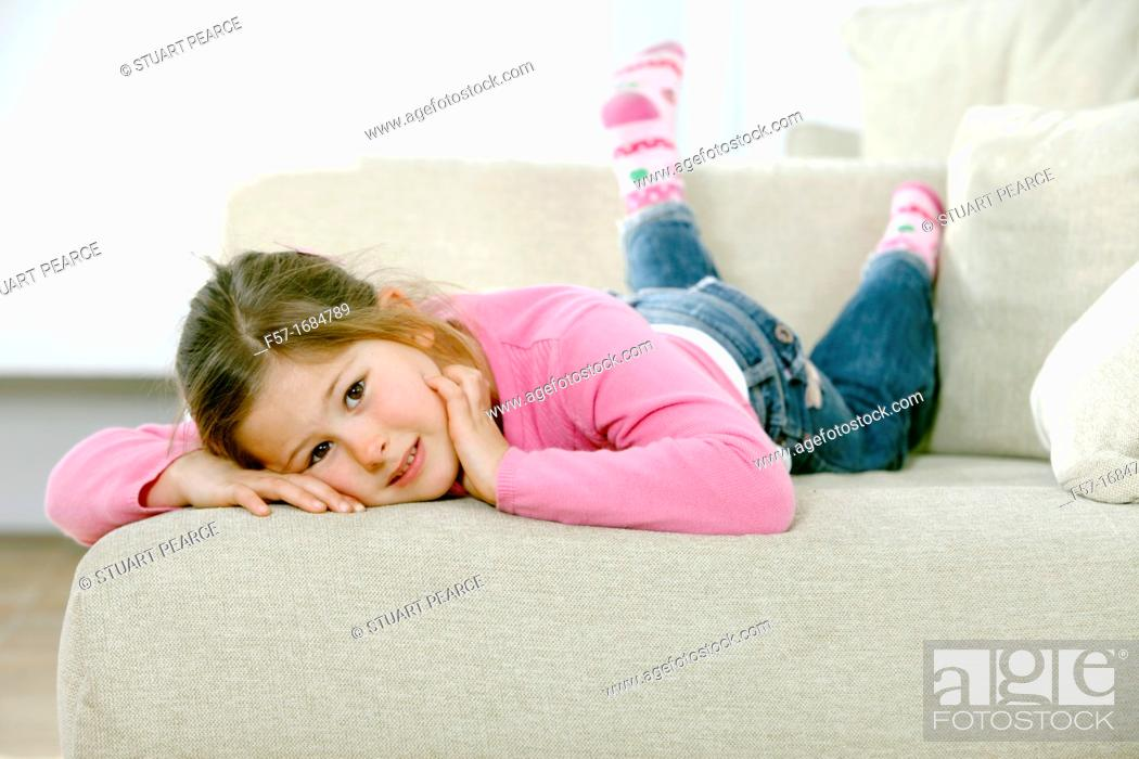 Stock Photo: Girl laying on coach.