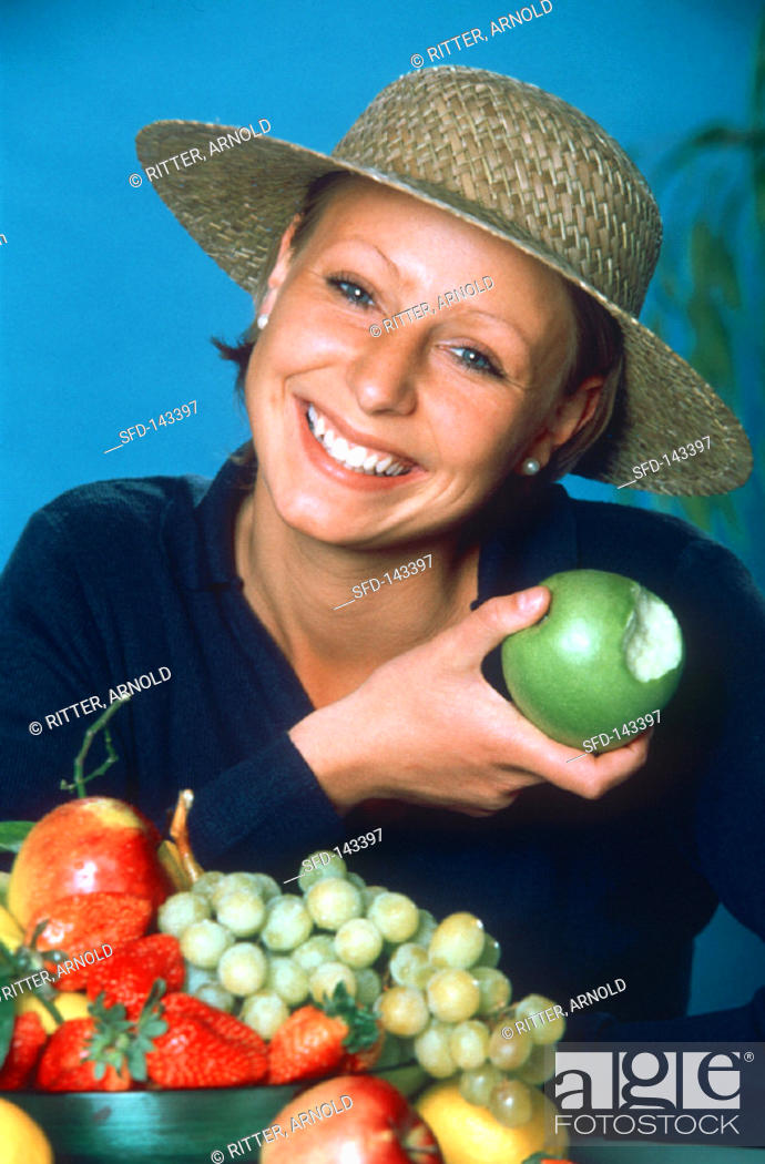 Stock Photo: A Woman Eating an Apple.