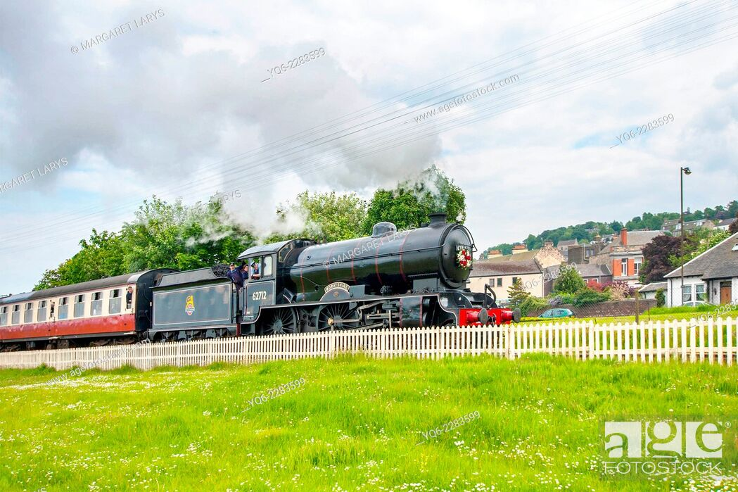 Stock Photo: Steam train at the Bo'ness Kinneil Railway passing the fields.